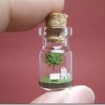 Miniature paper sculptures in bottles