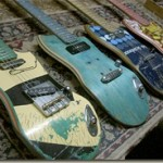 Beautiful guitars made out of stacks of recycled skateboards