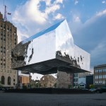 Wondrous mirrored sculpture as a universal symbol of homes lost