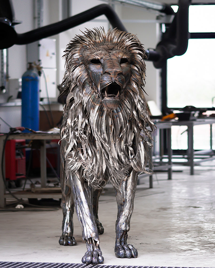 Highly detailed hand made metal lion sculpture created out