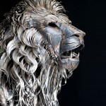 Highly detailed hand-made metal lion sculpture created out of 4,000 pieces of hammered scrap metal