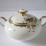 Vintage porcelain tea set covered with hand-painted ants