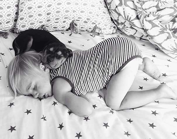 lovely-funny-cute-pictures-toddler-sleeping-with-puppy-dog (8)