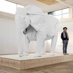 Life-sized elephant origami sculpture folded from a single sheet of paper