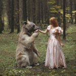 Wild animals and elegant girls together in dream-like photographs