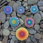 Mandala art on ocean stones
