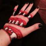 Artist painted her hand with creepy body art – Sliced up with bones showing