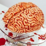 Creepy Walking Dead-themed brain cake made out of colored fondant and raspberry jam