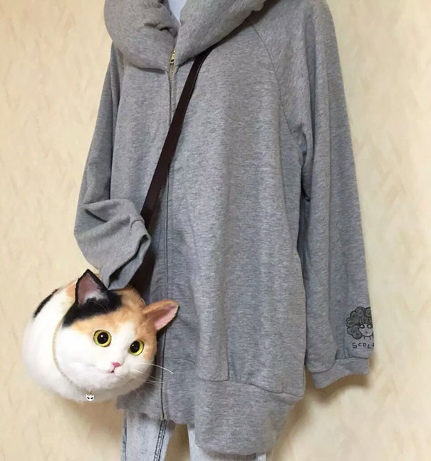 cute-funny-realistic-cat-hand-bags (8)