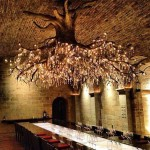Massive grapevine-like chandelier in cellars