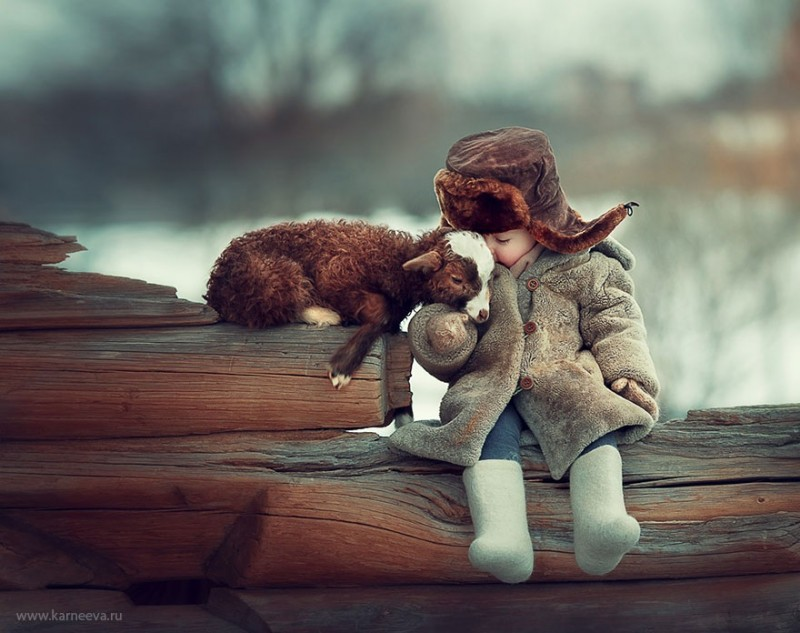 beautiful-winter-field-children-animal-playing-photographs (15)