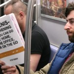 Comedian pretends to concentrate on publications with fake book covers on the New York subway to see how people react