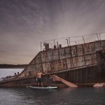 Unconventional mural of women floating in water on sunken ship