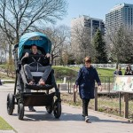 Giant strollers designed for parents to feel what their babies experience