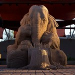 Amazing sand sculpture of a nine foot elephant playing chess with a mouse