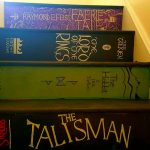 The family paints staircase in new home with covers of favorite books