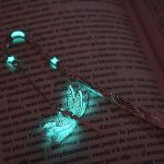 Exquisite bookmarks that emit turquoise light in the dark