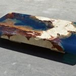 Ocean coffee tables made out of natural stone and resin that represents the ocean