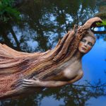 Driftwood spirit sculptures with ethereal beauty