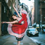 Beautiful photo shot of ballet dancers practicing on the streets of NY in motion
