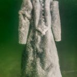 A black gown turns into a salt-encrusted artwork after 2 years salt crystalisation in the Dead Sea