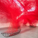 Surreal thread art installation by Japanese artist Chiharu Shiota