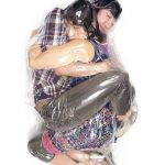 Unusual photos of couples wrapped-up in vacuum plastic bags