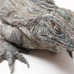 Realistic animal sculptures made out of newspaper