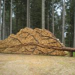 Works of art created out of piling logs
