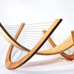 Stylish furniture crafted with wood and wire by tension integrity instead of nails or screws