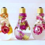 Beautiful blooms suspended in light bulbs