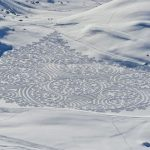 Massive site-specific geometric drawings tramped in snow and sand