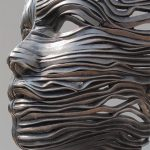 Statues composed of bands of stainless steel ribbons
