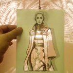 Fashion illustrator perfects his cut-out dresses with whatever he finds