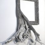 Sculptural picture frames perfectly fusing with tree roots and branches