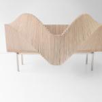 Novel cabinet from Sebastian Errazuriz Studio that opens in various wavelike ways