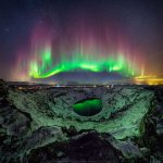 Wonderful shoot of northern lights and stars reflected in a crater lake in Iceland