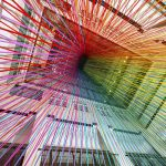 Colorful tape installation looks like a cascading rainbow