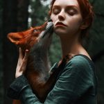 Fairy-tale photographs of redhead and red fox