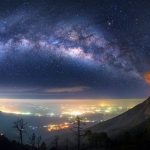 Erupting volcano ashes and the Milky Way in one photo