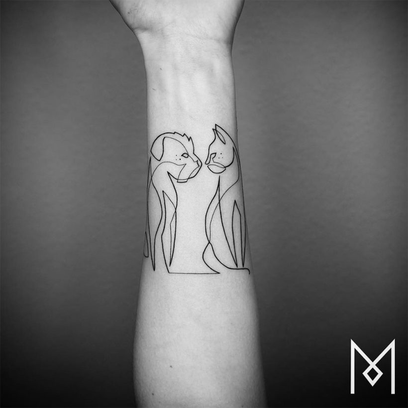 Continuous Line Drawing Tattoo : Tattoo artist draws a continuous line into minimalistic
