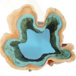 Wood tables and sculptures embedded with glass rivers and lakes