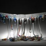 Jellyfish-like tables through glass fusion